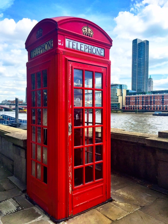 Iconic phone box with Oxo Tower in background.