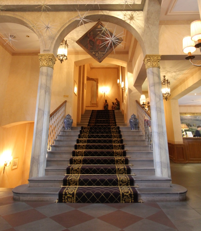 Carpeted ornate staircase of Les Trois Rois five star hotel